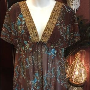 Sheer top with gold trim